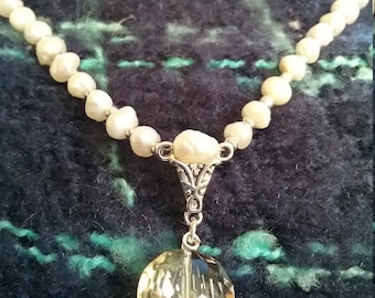 Cultured pearl necklace with Smoky Quartz pendant.