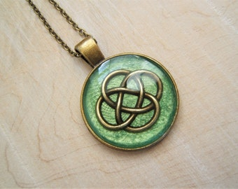 Green Celtic Knot pendant necklace. Lovers knot necklace. Handmade. Pagan necklace.  Handmade.