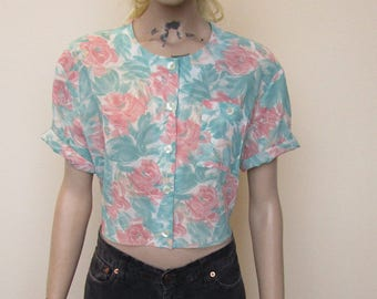 Cute ripped blue and pink crop shirt. Size 10-14