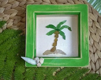 Genuine green sea glass palm tree collage, in a shadow frame.