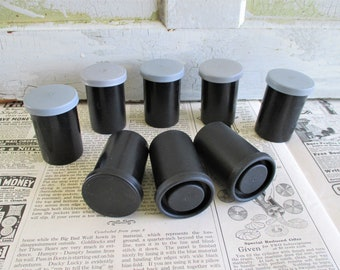 Eight Vintage Plastic Film Containers