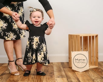 4-6 weeks, dress with Ruffles, Black Cotton/spandex, and double brushed poly yellow flowers on a black background