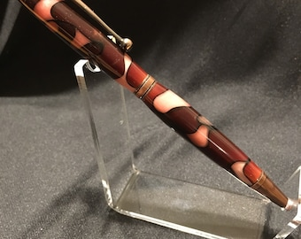 Pink and brown twist style pen