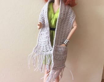 A scarf with a matching beret for barbie dolls