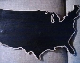 Wood United States cut out, painted with chalk board paint, has hanging hardware installed