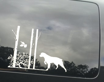 Dog Vinyl Car Decal - Brittany Spaniel - Dog with Flushing Grouse & Trees - Dog Decal - 9 x 14 - white
