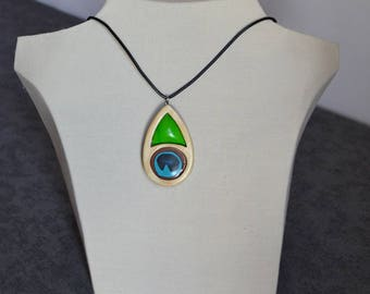 Pendant made in wood and accented with feather inspired polymer clay color Peacock