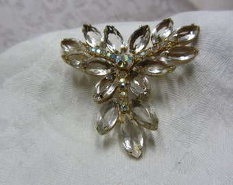 Clear Unfoiled Oval Rhinestone and Gold Tone Star Brooch