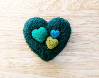 Green needle felted heart decoration or brooch pin.