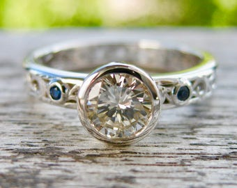 Diamond & Blue Sapphire Engagement Ring in 18K White Gold with Floral Scroll Motif Size 5