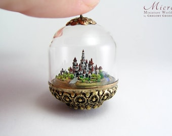 Miniature world inside glass dome, a tiny town is surrounded by landscape made up by tiny details