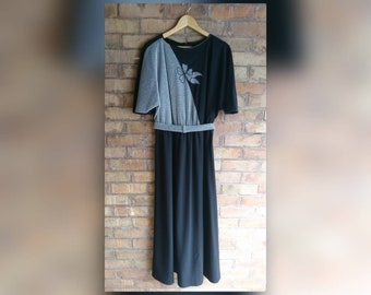 Vintage black maxi dress with silver mesh motif.