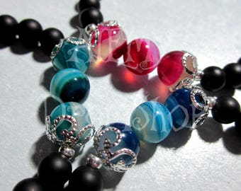 Real stone bracelets, available in pink, green and blue!