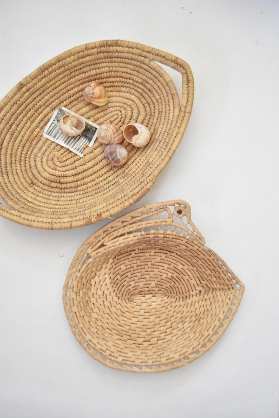 southwestern woven straw wall hanging basket with handles / serving tray