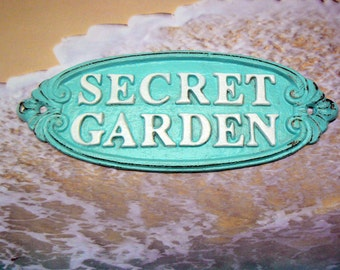 Secret Garden Gate Wall Plaque Sign Cast Iron Cottage Blue Raised Letters Bright White Oval Oblong Ornate Scroll Accented Wall Door Sign