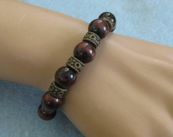 Brown glass beaded bracelet with bronze Tibetan spacers
