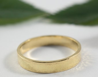 Gold Wedding Bands: A hers and hers set of 14k yellow gold textured wedding ring bands