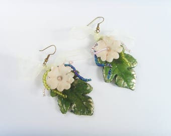 Flower and leaf earrings made of cold porcelain.