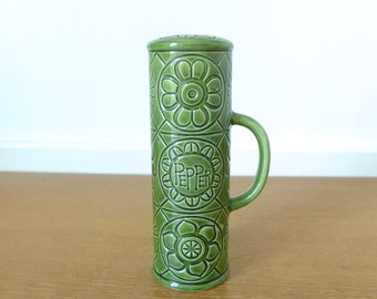 1960s Green pottery pepper shaker with retro floral design, made in Japan