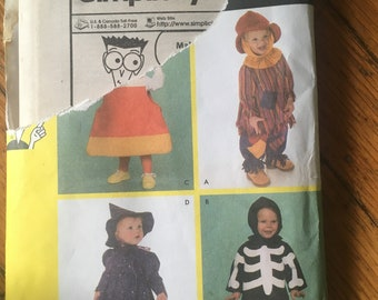 Simplicity Pattern #4005 4 Toddler Sizes 1/2 - 4  Features Scarecrow, Witch, Candy Corn and Skeleton