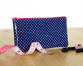 Navy blue pencil case with white polka dots