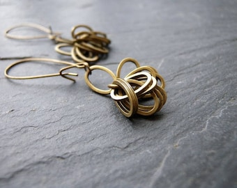 Long oval rings many earrings brass bronze