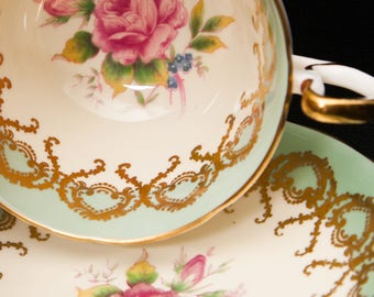 Sage and Ivory Aynsley Teacup and Saucer with Bouquet on Cup and Saucer.  Ornate gold designs.