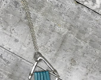 Long silver Chevron necklace with a row of turquoise coloured howlite spikes on a beautiful rolo silver chain, nickel and lead free