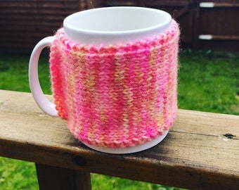 multi coloured pink mug cozy, mug cozies, gifts for her, gifts for him, birthday gifts, mug accessories, coffee lovers gifts, new home