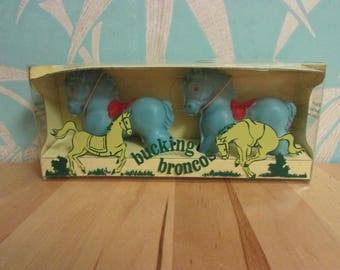 Pair of kitsch 1960s Delagar 'Bucking Broncos' blue horse-shaped novelty soaps
