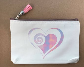 Cosmetic bag with pearl iridescent heart