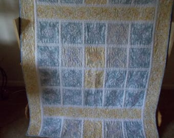 Pale yellow and blue quilt