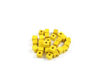1 strand of approximately 90 beads Turquoise synthetic yellow Cube approximately 4 x 4 x 4mm
