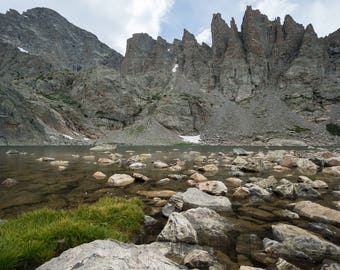 Calm water along the river's pointy rocks Wall Art
