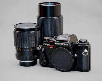 Pentax Program A camera with two lenses, 28-70 and 70-200.