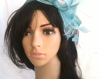 Aqua rosette fascinator ..on a headband  ..Stunning for races ,wedding.