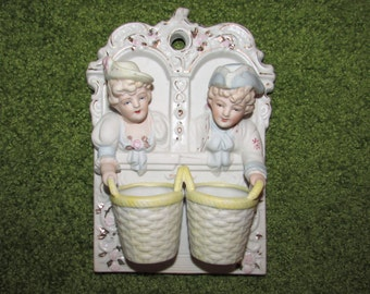 Vintage Porcelain Wall Mounted Pocket Match Striker and Holder by Chase, Man & Woman holding baskets