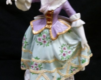 Continental figurine of lady with green dress  height=23cm