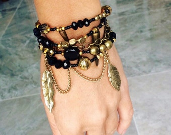 Black and Gold bracelet with golden leaves charms