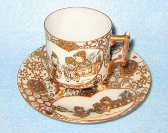 Demitasse-Gold and White Demitasse Cup and Saucer Set Asian Inspired.