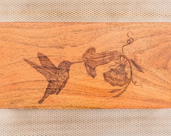 Not one but two Hummingbird adorn this jewelry box