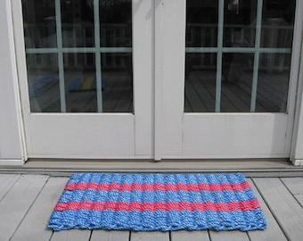 Nantucket red and blue handwoven doormat from lobster trap rope.