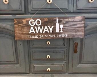 Come back w WINE sign