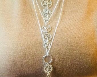 Cog cascade necklace, silver colour.
