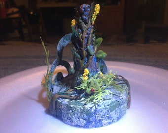 RPG statue of a lady aged and overgrown