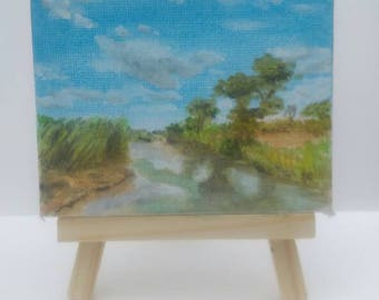 A stream in Africa watercolour painting on mini canvas 7x9 with easel.