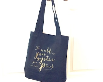 tote bag. large market tote in black and gold. the world is your oyster.