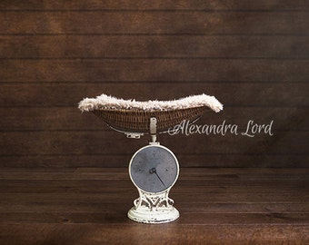 Antique weighing scales with fur and wooden barn backdrop