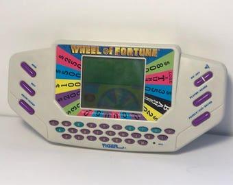 1995 HANDHELD VIDEO GAME vintage electronics Wheel of Fortune Vanna White tiger cartridge working game show