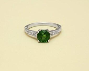 18K white gold hand engraved ring.  Bright cut Tsavorite garnet, wt 1.59 cts.